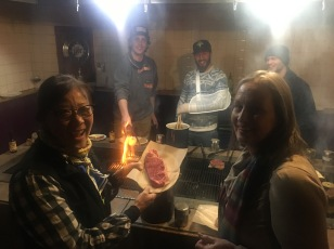 Cooking our supper on the communal grill. Snowboarders on the other side! Me and Mo.